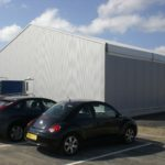 Temporary sports hall with secure cladding to exterior