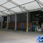 Loading Canopy Panic Transport next to warehouse