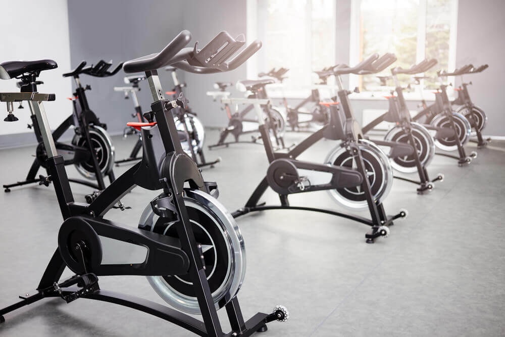 spin class set up in modular fitness building